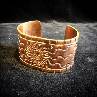 "BRACE COPPER CUFF ""FATHER SUN WARMS HIS CHILDREN"""